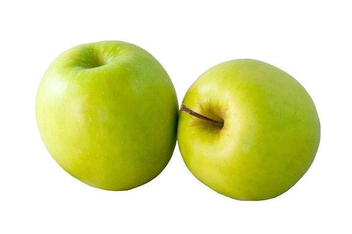 two organic granny smith apples on a white background